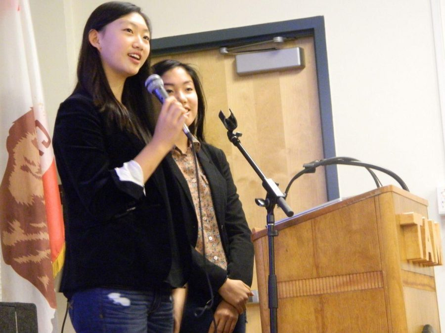 Co-presidents of Amnesty International Leah Jun and Lilly Kane-Darci speak to the audience during the dinner on Dec. 10.