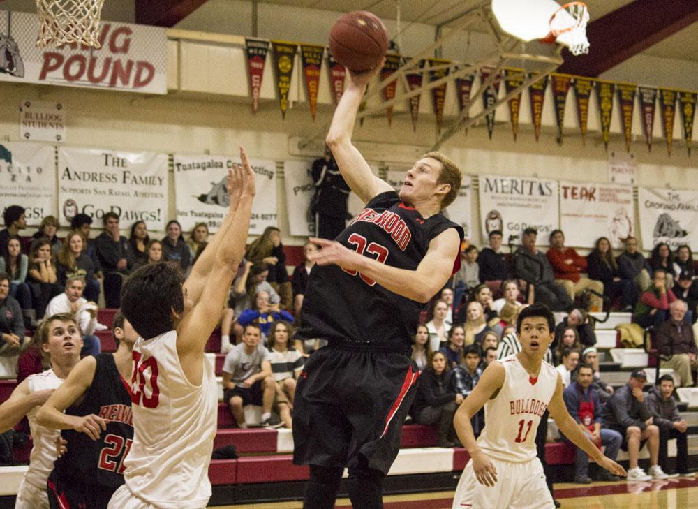 Boys' varsity basketball towers over Bulldogs in MCAL opener