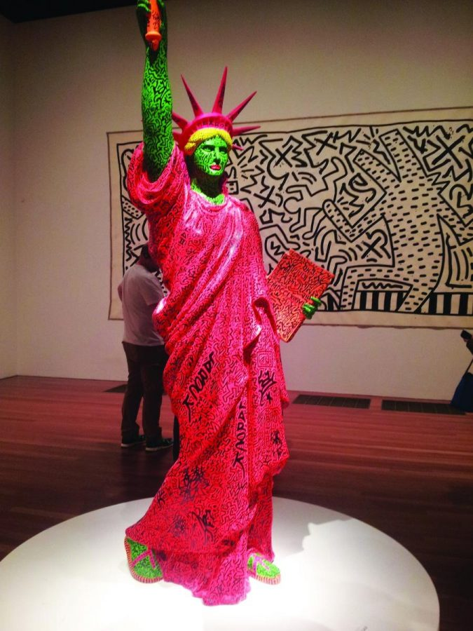 GREETING VISITORS as they walk into the Keith Haring exhibit, this statue stands proudly. The exhibit will be at the DeYoung until Feb. 16.