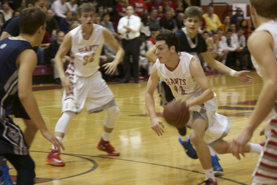 Boys' varsity basketball loses rival game