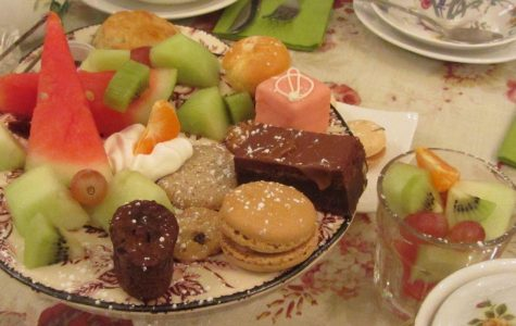 Brownies, assorted fruits, and pastries are delightfully served in the