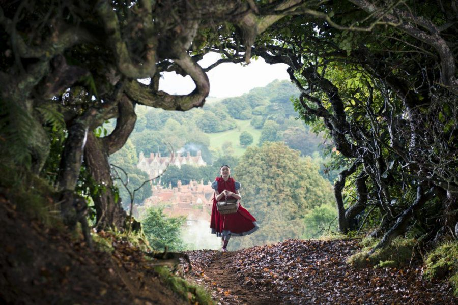 Little Red Riding Hood, played by Lilla Crawford, skips 'Into the Woods' while singing the film's title song