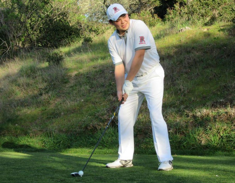 Senior Yoshio Boris lines up his swing at the Meadow Club on March 2.