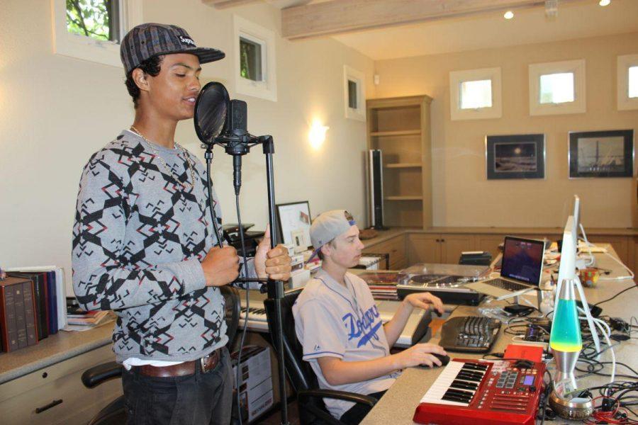 Clemons and Pratt work on their music in Pratt's home studio.