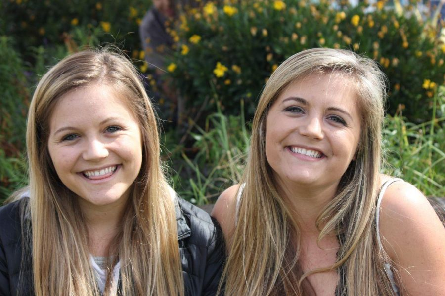 Senior identical twins Roxanne and Racquel Rivette pose for a photo