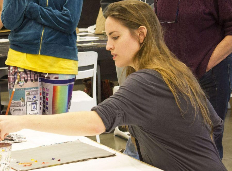 Olivia Wise demonstrates her painting techniques as a guest artist during Artist Voice.