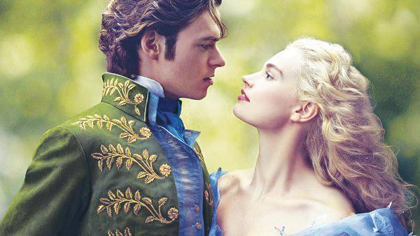 CINDERELLA, portrayed by Lily James, stares into the eyes of the Prince (Richard Madden) in the new live action Disney film Cinderella.