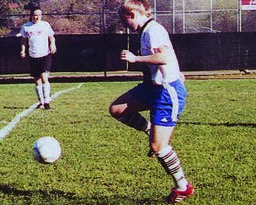 Amy Mastromonaco, a 2005 alumus and four year varsity soccer player, dribbles a soccer ball.