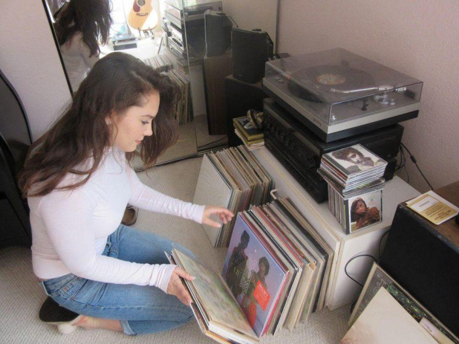 Sophomore Tara Antee sorts through her extensive collection of vinyl records
