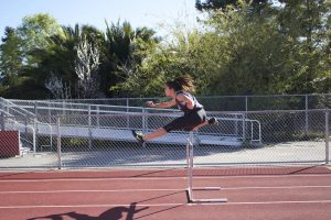Frangoul practices hurdles and shot put during seventh period.