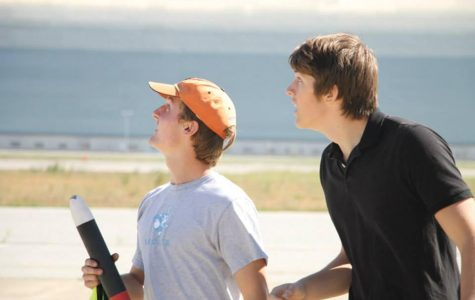 Juniors Isaac Perper (left) and Max Lukianchikov (right) watch another team's rocket take off at Moffet Field on March 29. The team will travel to Virginia in May to compete for the title of National Champion.