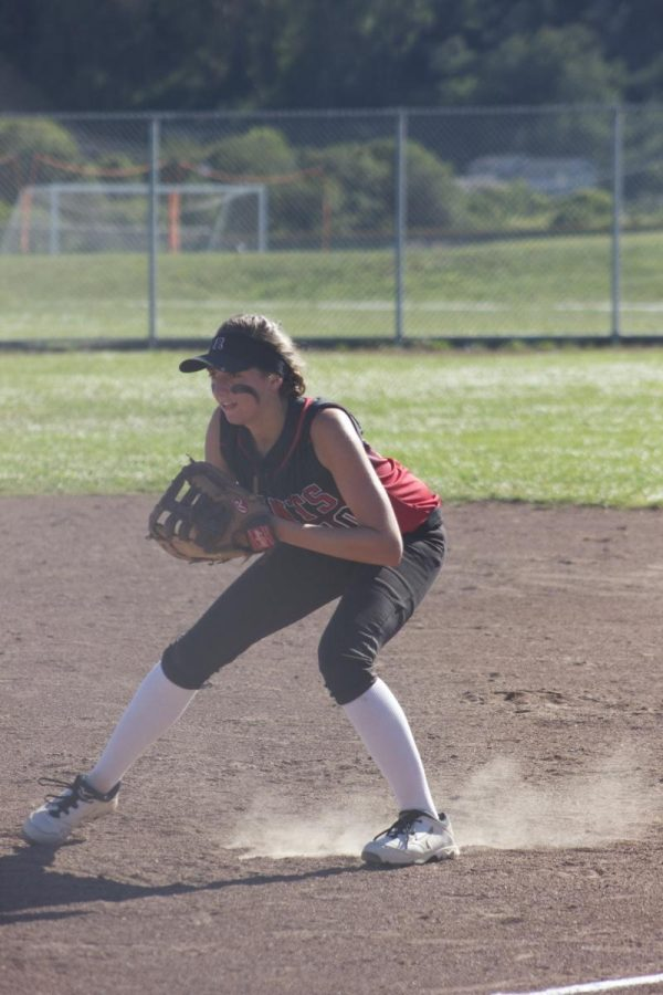 Junior Kayla Rose works on fielding during practice.