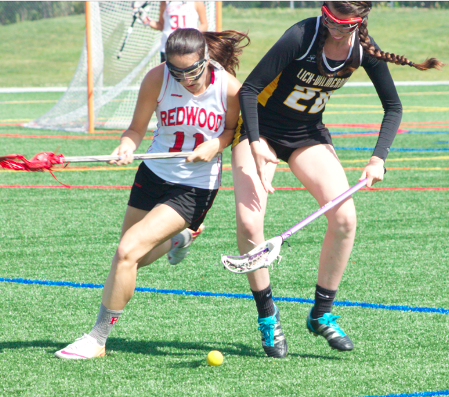 Junior Jenny Green competes for a ground ball.