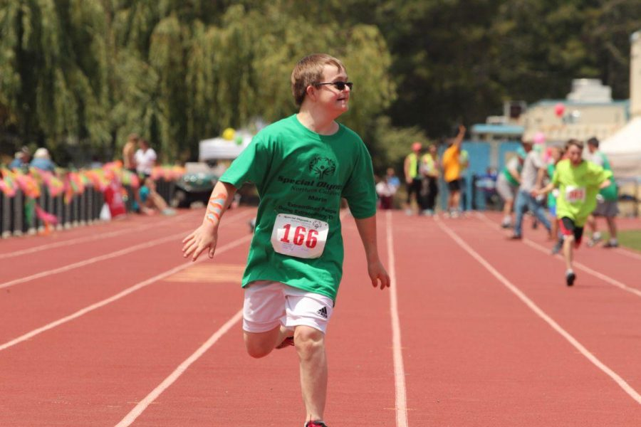 Running in a track meet, Griffin Herz, brother of senior Alex and sophomore Jenna, doesn't allow his Down Syndrome to affect his day-to-day life.