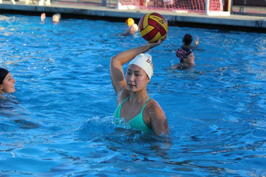 Junior Jennifer Kieffer passes the ball to a teammate during practice on Sept. 9th 2015.