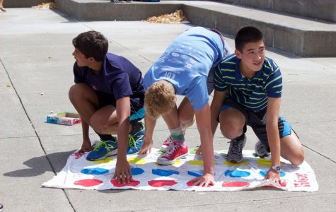 Freshmen Gabe Johnson, Miles Dean, and Nathan Kim (from left to right) play Twister during a Link Crew mini event on Friday, Aug. 28.
