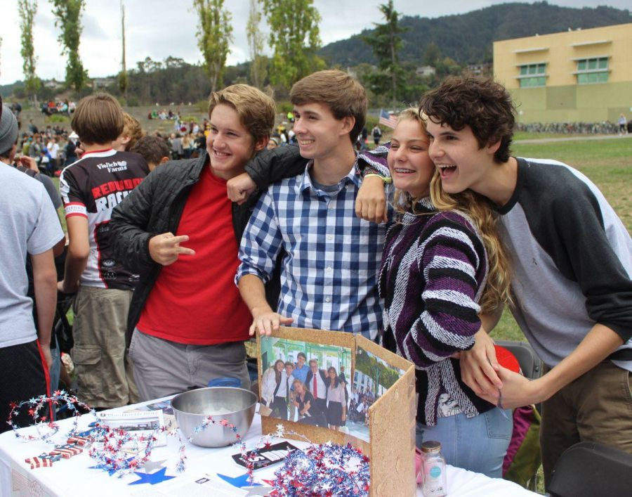 Students Miles Johnson, Ryan Mishoe, Ali Janku, and Jake Hanssen pose behind the JSA table.