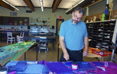 Douglas Dammarell, the new art teacher, poses in his classroom.