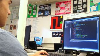 Senior Matt Berry programs through Minecraft, a specialized coding game, during workshop day, Oct. 14.