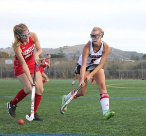 Junior Neeve Kennedy fights for the ball in the seasons final game.
