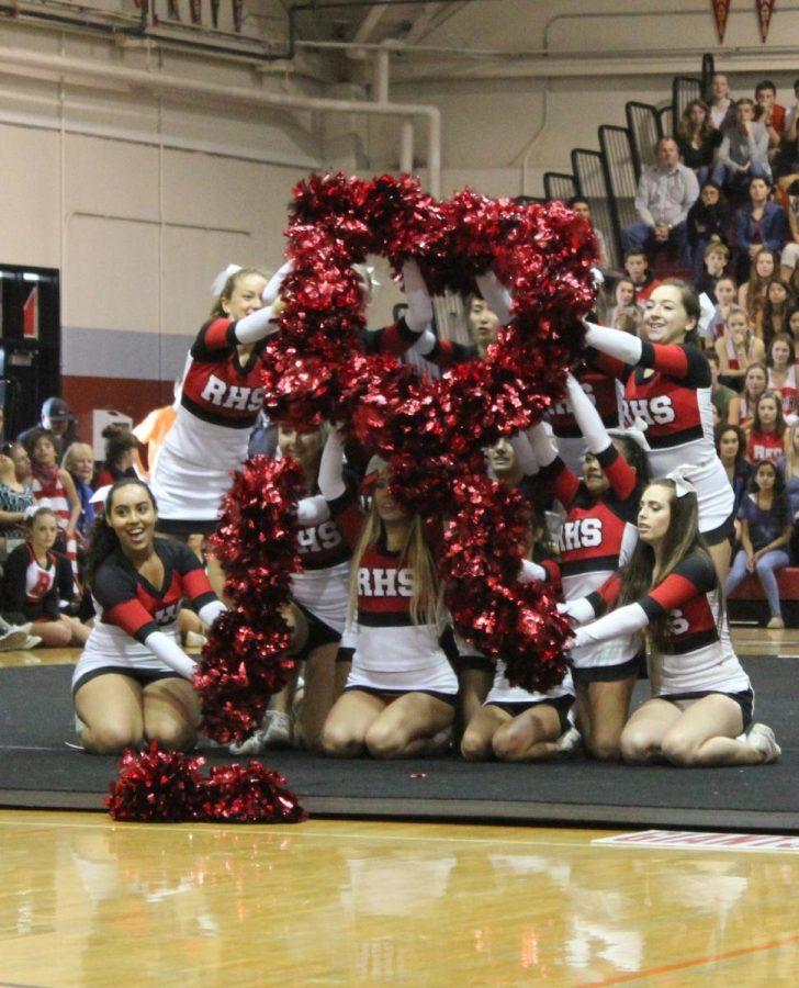 Cheerleaders show their school spirit.