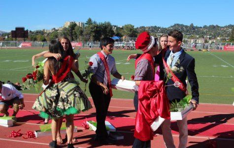 Several homecoming participants hug after crowning of Wong and Vega