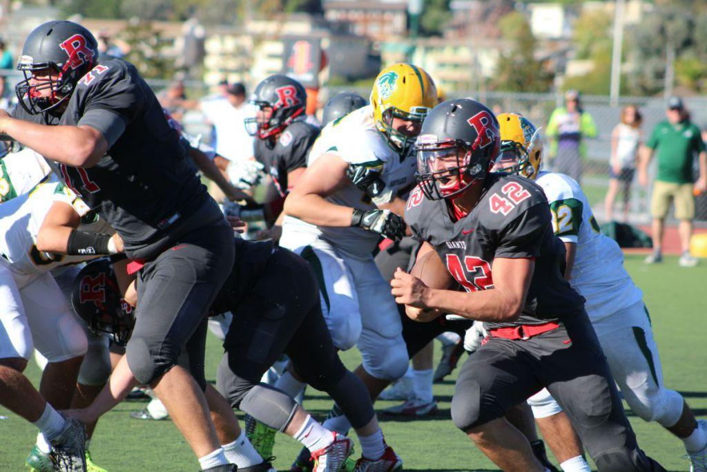 Junior running back Nick Calzaretta runs through the San Marin defense trying to pick up the first down.
