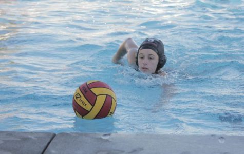 Senior Sophie Parker rushes toward the ball during the second period.