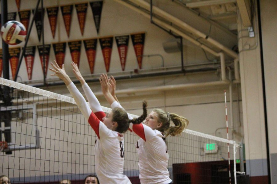 Junior Mckenzie Cooke (left) and senior Marguerite Spaethling attempt to block the volleyball in their game against San Rafael.