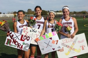 Seniors pose with the poster and flowers they were given during their farewell ceremony.