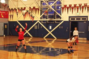 Freshman Sally Noble serves ball in second match against Tam on Friday, Oct. 23