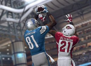 Lions wide receiver Calvin Johnson catches a ball over Cardinals cornerback Patrick Peterson in a