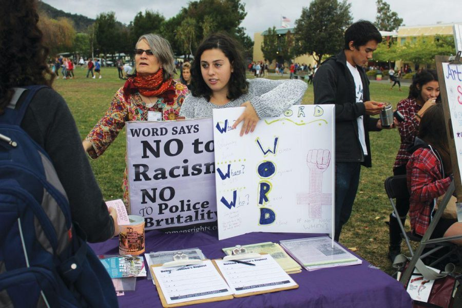 Senior Ruby Elson recruits members for WORD during club day with the help of Anne Gamboni (left), a member of their San Francisco chapter.