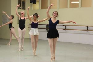 Junior Caitlyn Reed rehearses for her role as part of the Snow Trio.