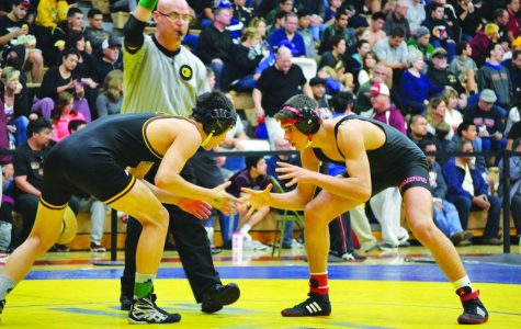 Junior Simon Ermolov faces off against his opponent. Ermolov was one of many who helped in the wrestling team's success last year.