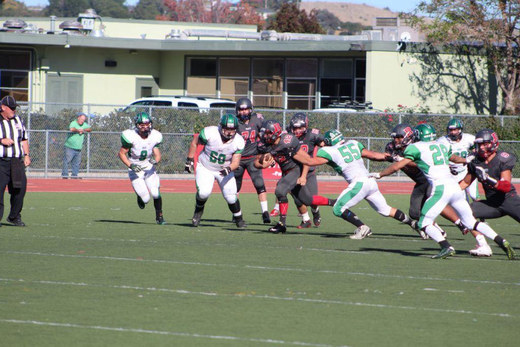 Junior Nick Calzaretta breaks a tackle against Drake en route to a massive gain.