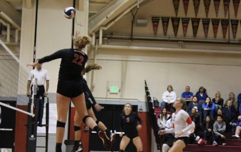 Senior Middle Margo Spaethling hits the ball during the first set of Redwood's NorCal semi-final game against Presentation on Nov. 28.