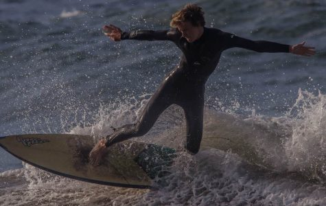 Senior Cale Smith drops in to a wave, while surfing at  Fort Cronkhite.