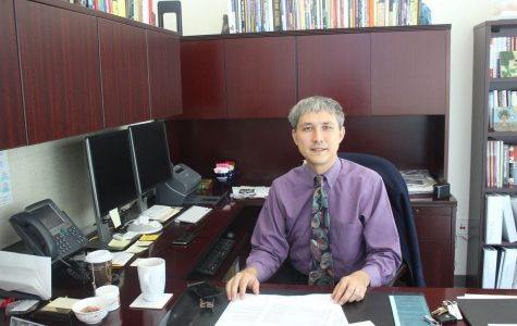 Dr. David Yoshihara sits in his new office.