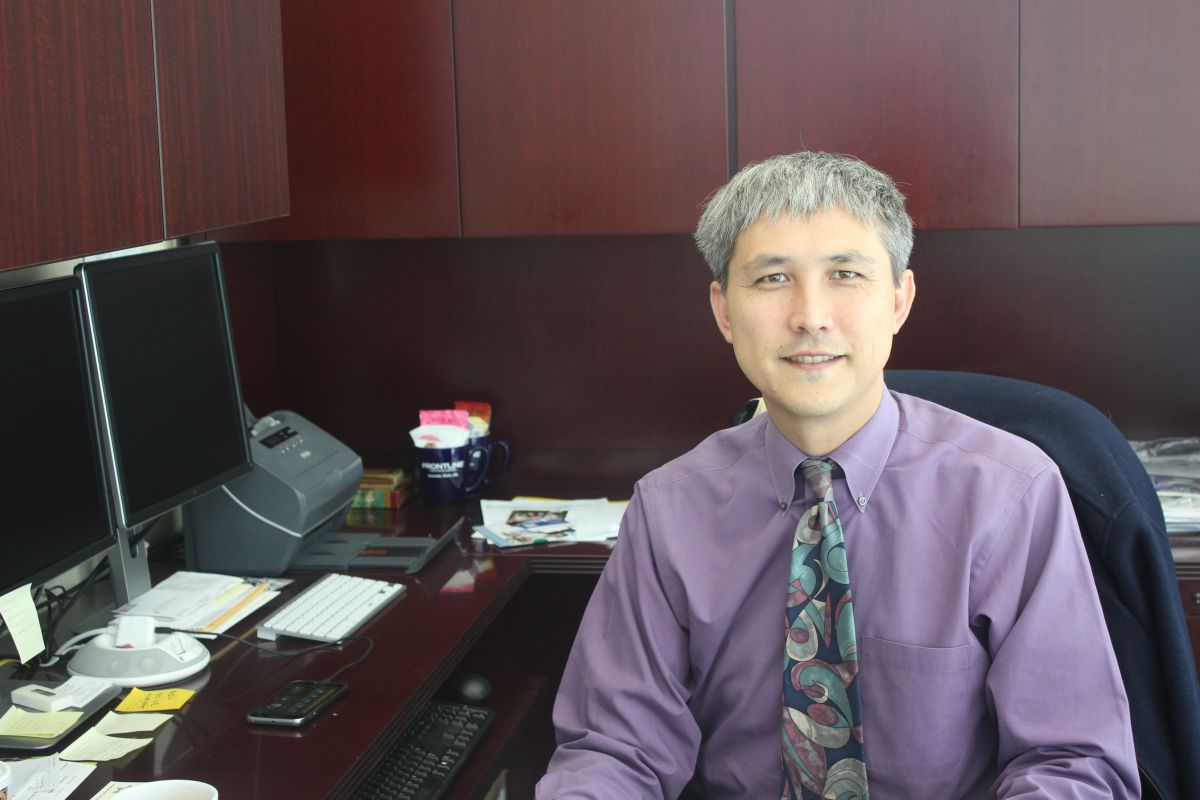 DR. DAVID YOSHIHARA sits in his office located in the district offices on campus.  He is working to aid communication and offer equal opportunity to all students.