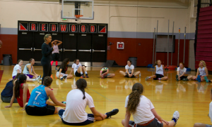 Coach Diane Peterson talks to members after the first night of tryouts.