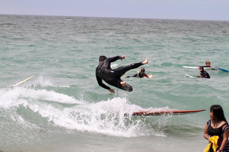 Senior Dea Edington flies off his board.