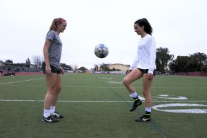 Lauren Foehr and Hannah Halford juggle the ball after their practice