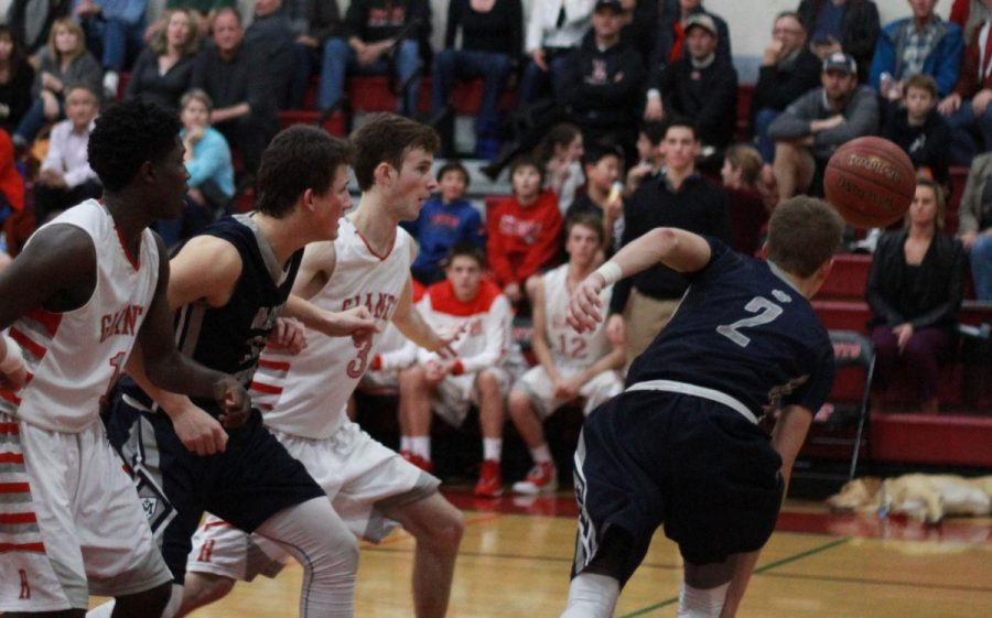 Junior Brendan Shepard lunges in for a steal.
