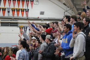 The Redwood fans cheer after a Redwood three-pointer.