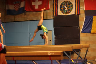 Smart practices her beam routine at practice at GymWorld in San Rafael.