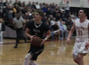 Junior Joey Calcaterra prepares to lay the ball in the hoop.