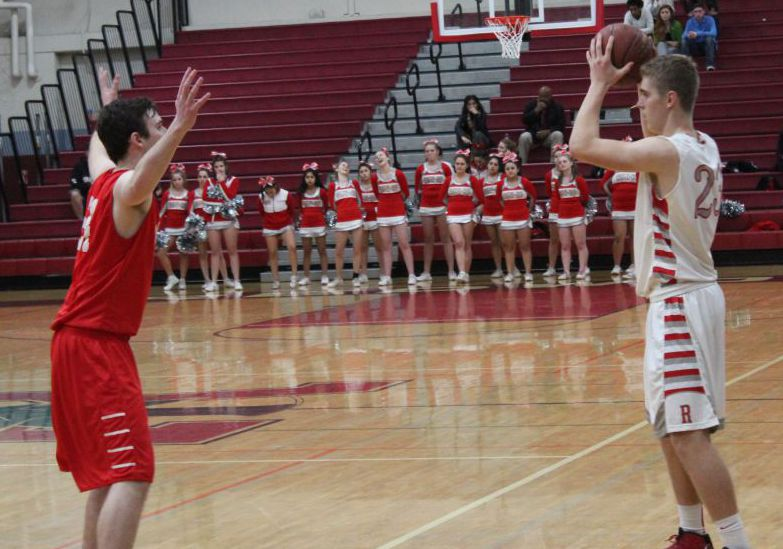 Boys' varsity basketball pulls away in fourth quarter, avoids late-game scare
