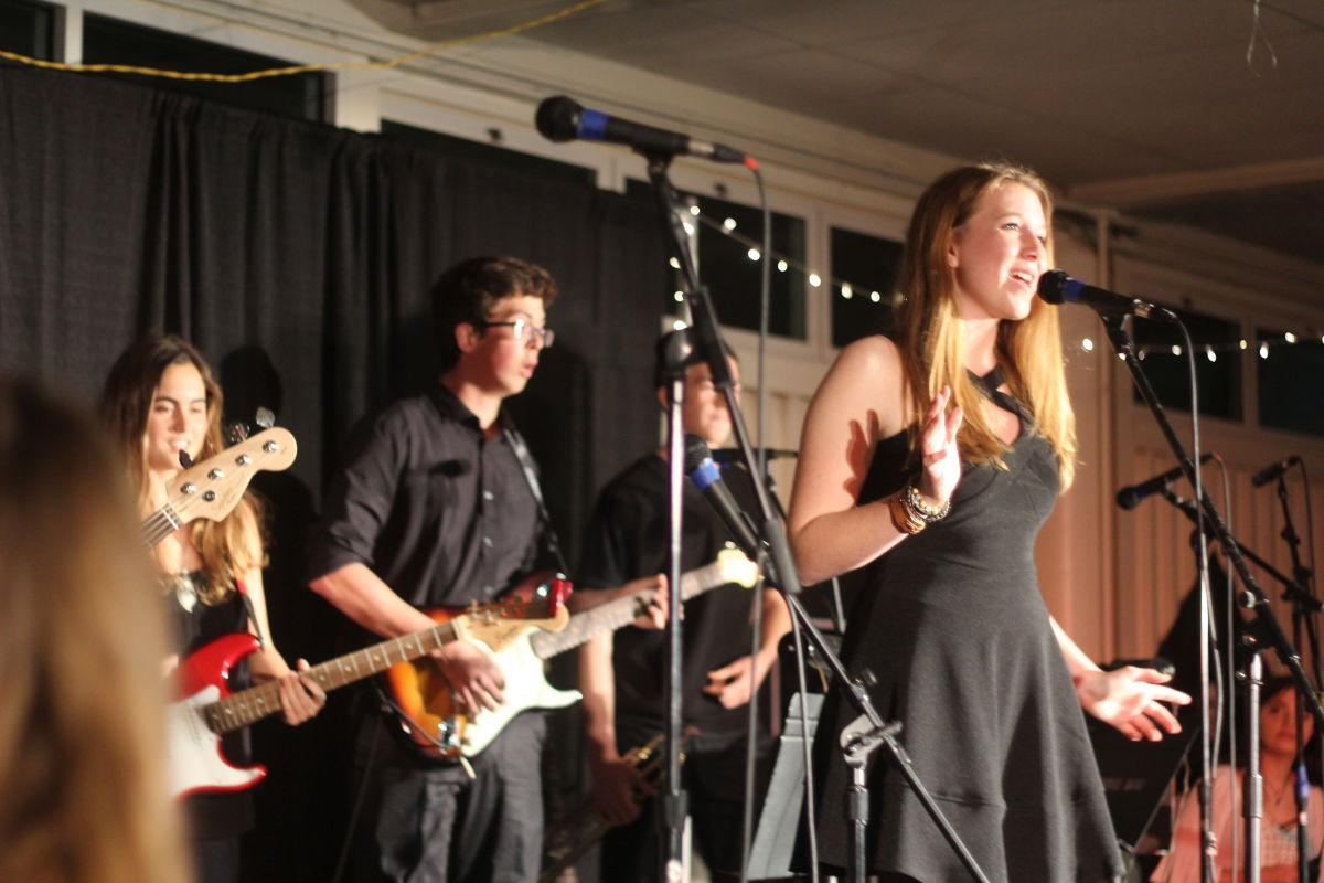 Sophomore+Cece+Kurnik+sings+during+the+event.+