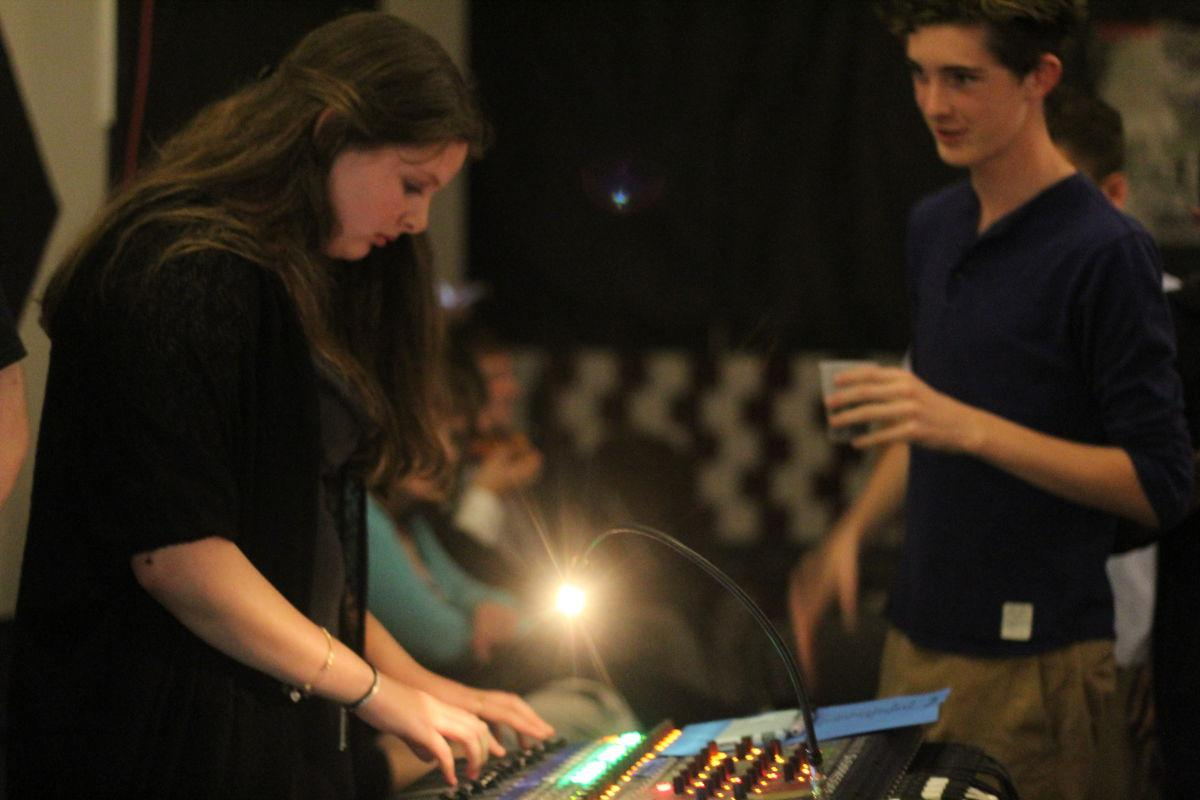 Freshman+Lily+Baldwin+works+the+soundboard.+